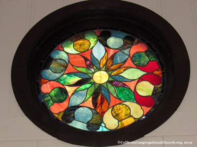one of the beautiful stained glass windows in the historic Collbran Congregational United Church of Christ